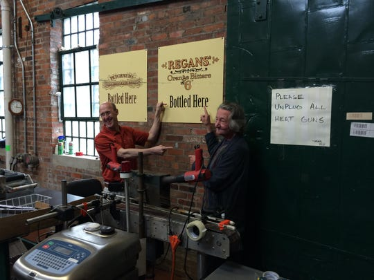 "Mark Brown (left), president of Buffalo Trace, shows off the bitters distillery with Gary Regan, the legendary English bartender whose orange bitters are made there. Regan was one of the judges of the ""Holy Grail"" project."