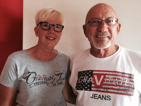 Margaret and Bruce Meyer show off Gravitate Jeans T-shirts.
