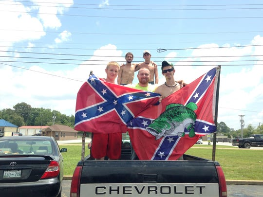 Rally participants pose for photos before driving to Nathan Bedford Forrest State Park.