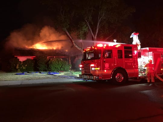 "Visalia firefighters used a ""deck gun"" on a fire engine Saturday night to spray a high-pressure stream of water onto flames gutting a home in the 2200 block of SouthTerrace Street. The fire spread to a house next door."
