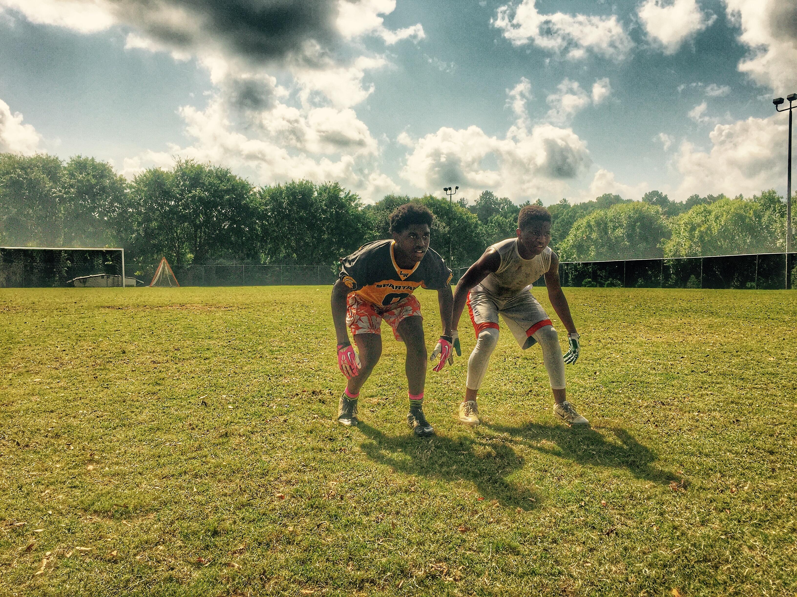 """Lincoln defensive back Raekwon Archer (left) gets ready to fight for a ball with a teammate during summer workouts last week, on a day dubbed """"Competition Thursday."""""""