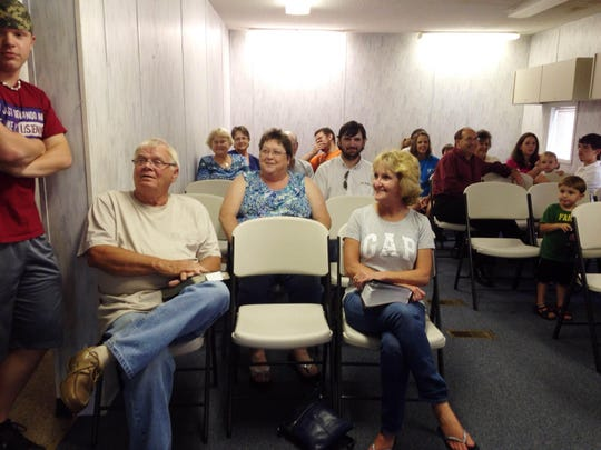 Congregation members met in the neighboring education building Wednesday night to share memories and Scripture.