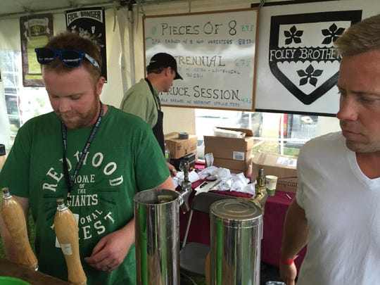 Dan, left, and Patrick Foley of Foley Brothers Brewing pour beer Friday during the Vermont Brewers Festival at Waterfront Park in Burlington.