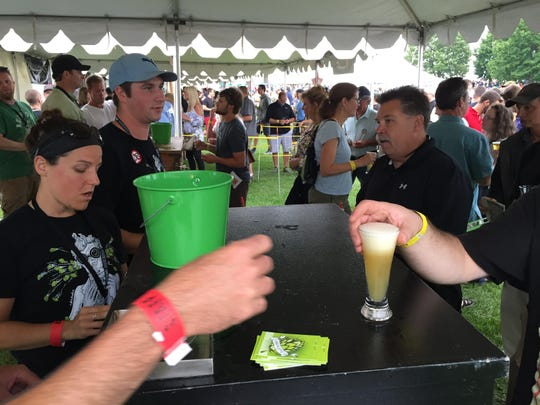 Beer tasters get served Focal Banger at the Alchemist tent during the Vermont Brewers Festival at Waterfront Park.