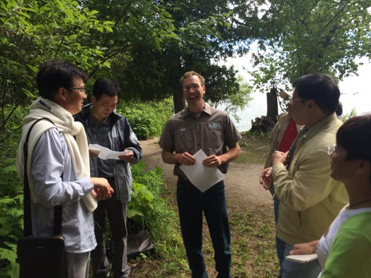Parks Director Erik Aelson talks about Cave Point County Park with the visiting Chinese delegates to Door County.