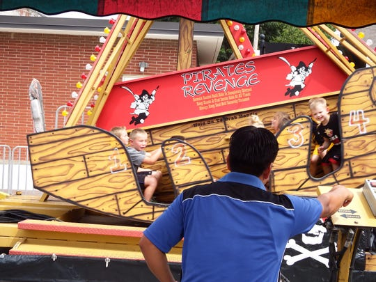 Kids enjoy a fair ride in downtown Solon as apart of Beef Days on Saturday.