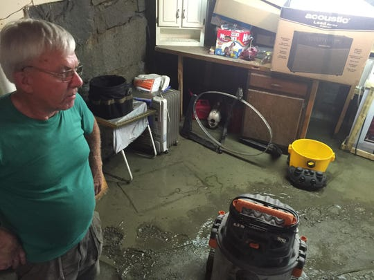 Bob Benoit spent Monday morning emptying his basement of water and mud. Benoit owns a home on Brook Street, next to Gunners Brook. The area has flooded three times since he bought the home in 1974, Benoit said.