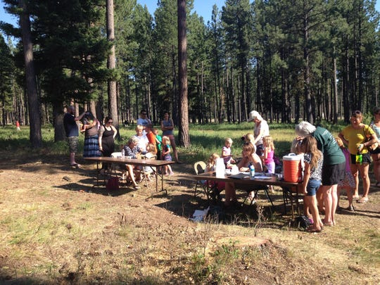 Children and parents participate in the Bug Rodeo on July 3 presented by Blackfoot Pathways: Sculpture in the Wild.