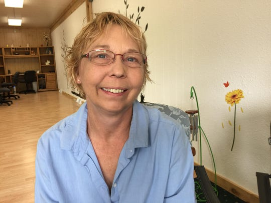 """""""My mom would take vacation time and we go to my grandma's cottage, where we would fish, and then we would eat the fish for supper. My grandpa would also take us out water skiing all day."""" — Tonya Rosandich, 54, of Wausau."""