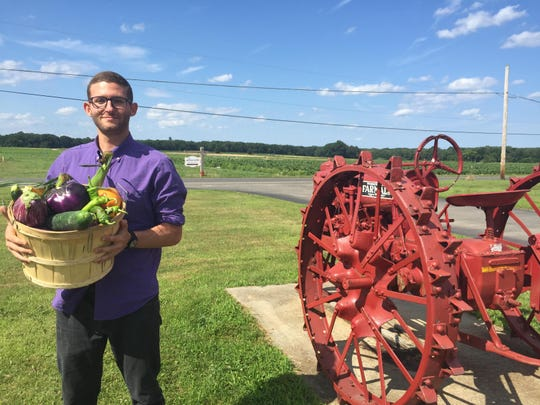 Harvest Drop founder Oliver Gubenko with produce picked from DeWolf Farm in New Egypt.