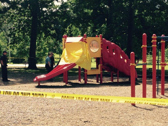 A yellow plastic tarp covers a slide at Canby Park on Thursday morning.