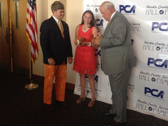 Before Monday's ceremony started, Fulmer posed for pictures and signed various Tennessee football items.