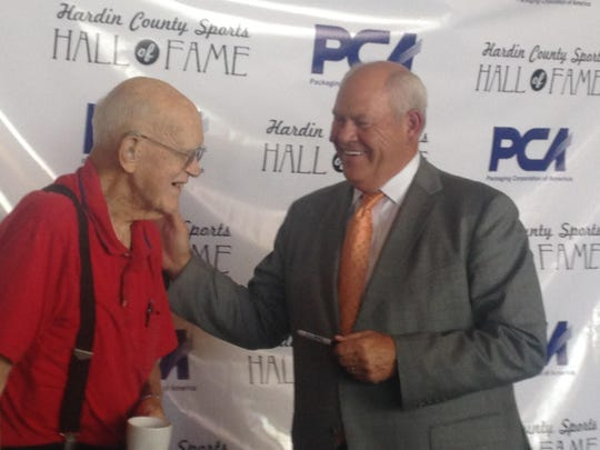 Phillip Fulmer shared a smile with Louie Abrams, left, who was part of the 1944-45 Savannah Central basketball team honored Monday.