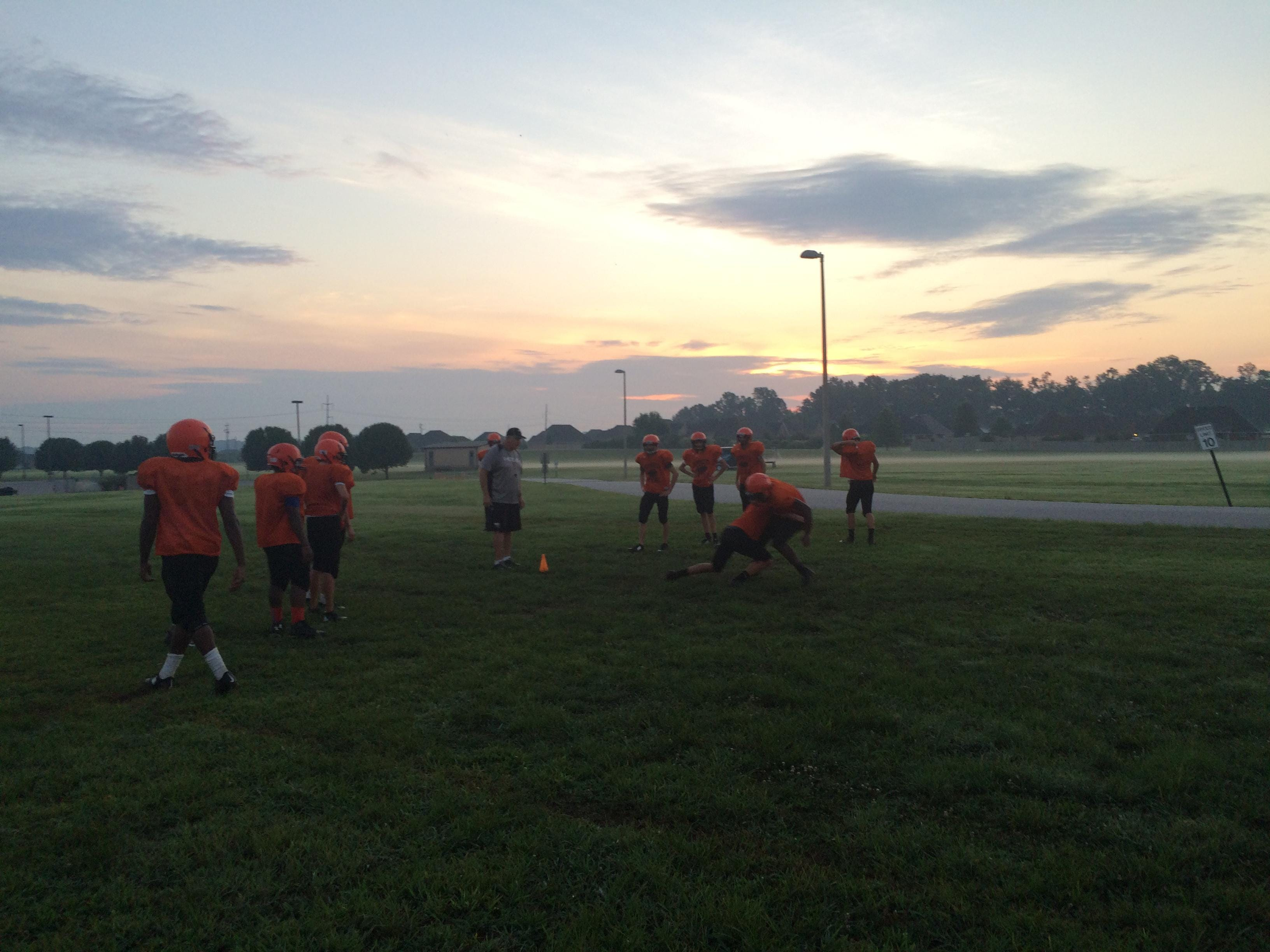 South Gibson's players line up for tackling drills before the sun has come up over Medina on Monday morning.
