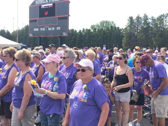 Cancer survivors leading the 2015 Manitowoc Relay for Life.
