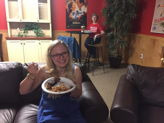 Chemist Jennifer Weisenburger, 23, of St. Albans and retired systems engineer Anne Henderson, 66, of Milton eat Afghan food at a Bernie Sanders gathering in Colchester