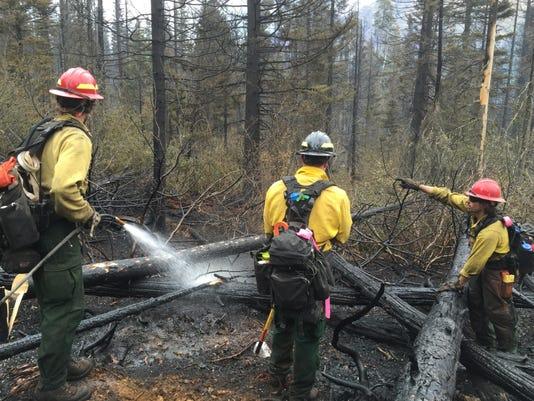 -firefighters spray hot spots.jpeg_20150729.jpg