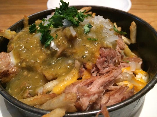 Carnitas Fries from BJ's Restaurant & Brewhouse were made with thin crisp fries, shreds of pork, cheese and a tangy salsa verde.
