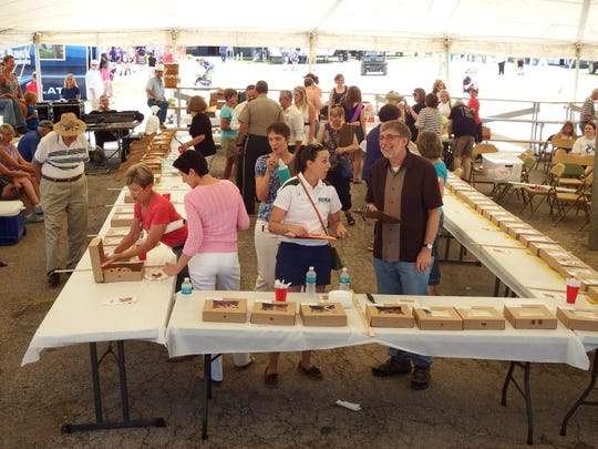 The assembled crowd of judges, participants and on-lookers at the 9th annual Jo Beers Pie Contest & Auction on July 30, 2015.