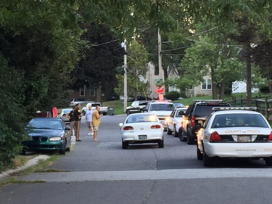 New Castle County police respond Friday to a reported shooting in the 100 block of New York Ave. in Claymont.
