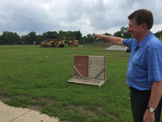 Lee Stienbarger, principal of Rose Hamilton Elementary School in Centerville, points out the area where new classrooms will be built during the 2015-16 school year.