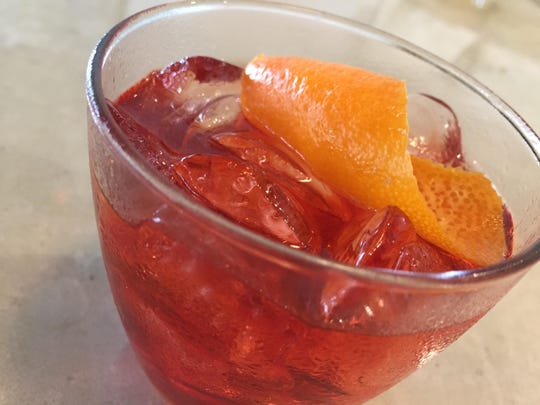 Pioneer's coffee-infused Negroni contains gin, sweet vermouth and Campari with coffee beans, orange peel and pink peppercorns.
