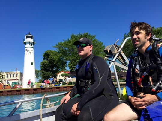 Dive team members William Wuebben and Matt Graham stay prepared for any issues during a childrens fishing tournament at the Marine City Maritime Days.
