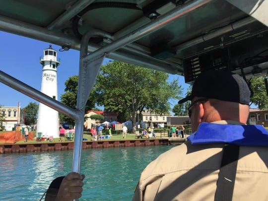 Mike Bricker, an assistant dive chief with the St. Clair County Sheriff Dive Team, patrols the St. Clair River during Marine City Maritime Days.