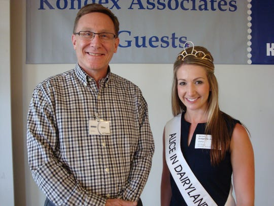 Kondex Vice President of Human Resources & Organizational Development Mike Frydryk poses with 2015 Alice in Dairyland, Teyanna Loether, during the recent Ag Day Escape.