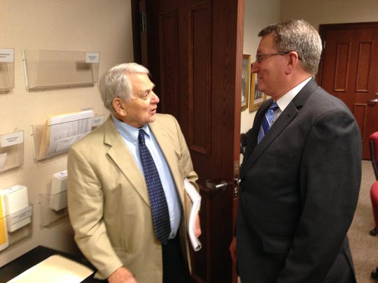City Councilman Pepper Bray, left, and Beer Board chairman Charles Rahm discuss Tuesday's meeting.