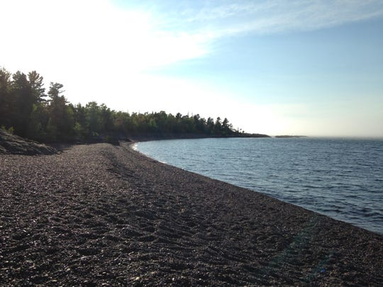 A polished pebble beach on the Hunter's Point loop trail near Copper Harbor.