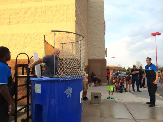 Dover Police Department Cpl. Jeff Davis gets dunked during the department's National Night Out Tuesday evening.