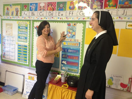 Pre-K 3 teacher Gail Callahan (left) speaks with St. Frances Cabrini Elementary Principal Nina Vincent in her classroom during an in-service day on Wednesday.