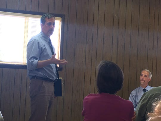 Joe Cincotta, attorney for STOMP, addressed the crowd at a public hearing last August on a plan to build a sand mine.