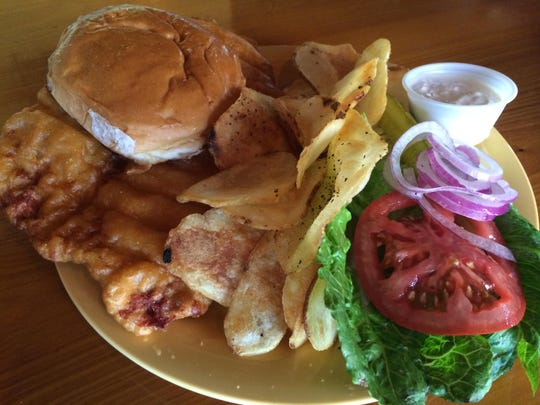 The signature Hoosier Tenderloin sandwich from Hoosiers in Paradise on Fort Myers Beach.