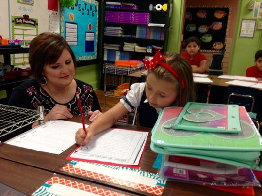 Cherokee Elementary third-grade teacher Lindsay Cooper welcomes Kaelyn Dasko, 7, on the first day of school in Rapides Parish on Monday.