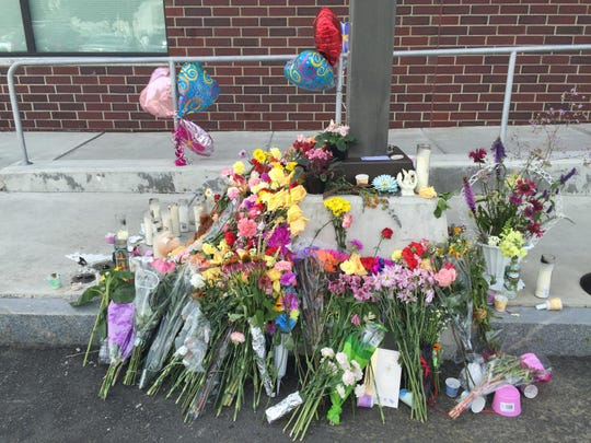 A memorial for social worker Lara Sobel is seen in the days following her killing outside the Department for Children and Families in Barre.