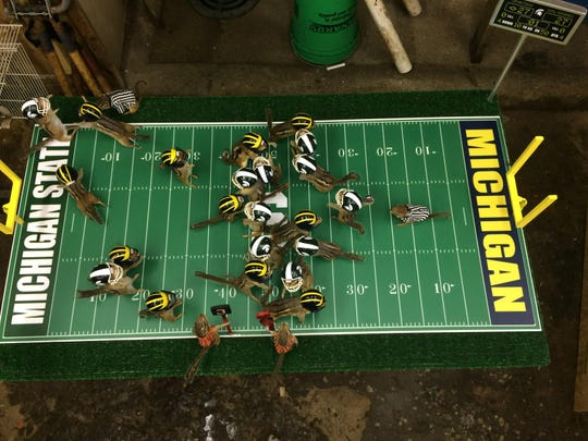 Twenty-six chipmunks are staged in a Spartan-Wolverine football rivalry. The piece by a Lansing taxidermist sold to a New Jersey U-M fan.