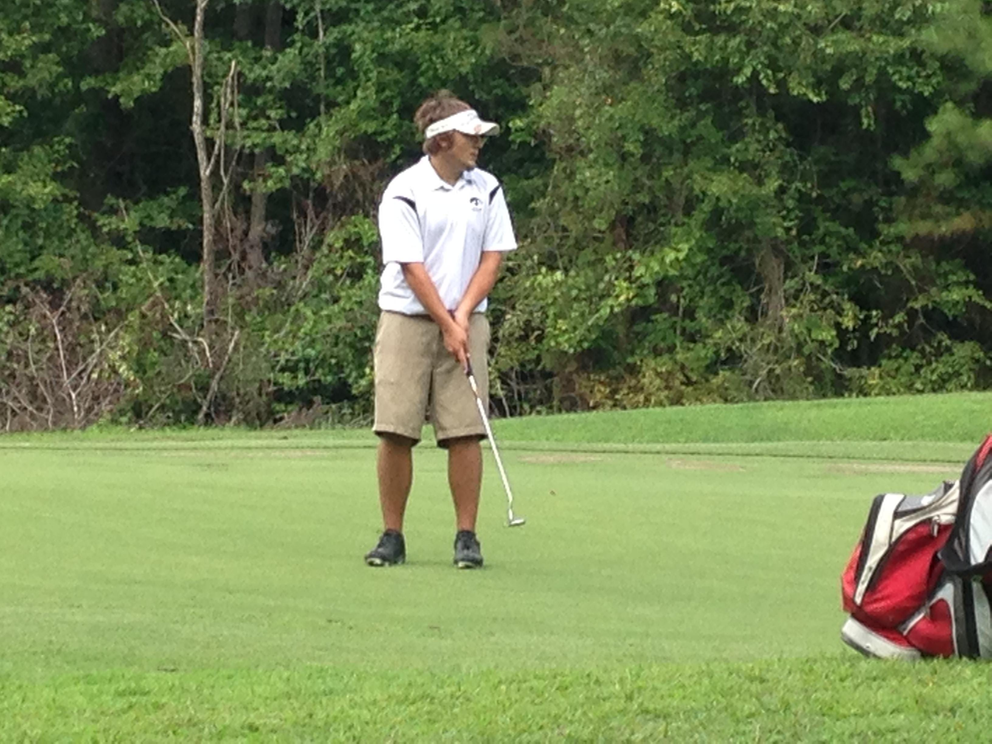 A South Side golfer watches his putt Tuesday at Chickasaw Golf Course.