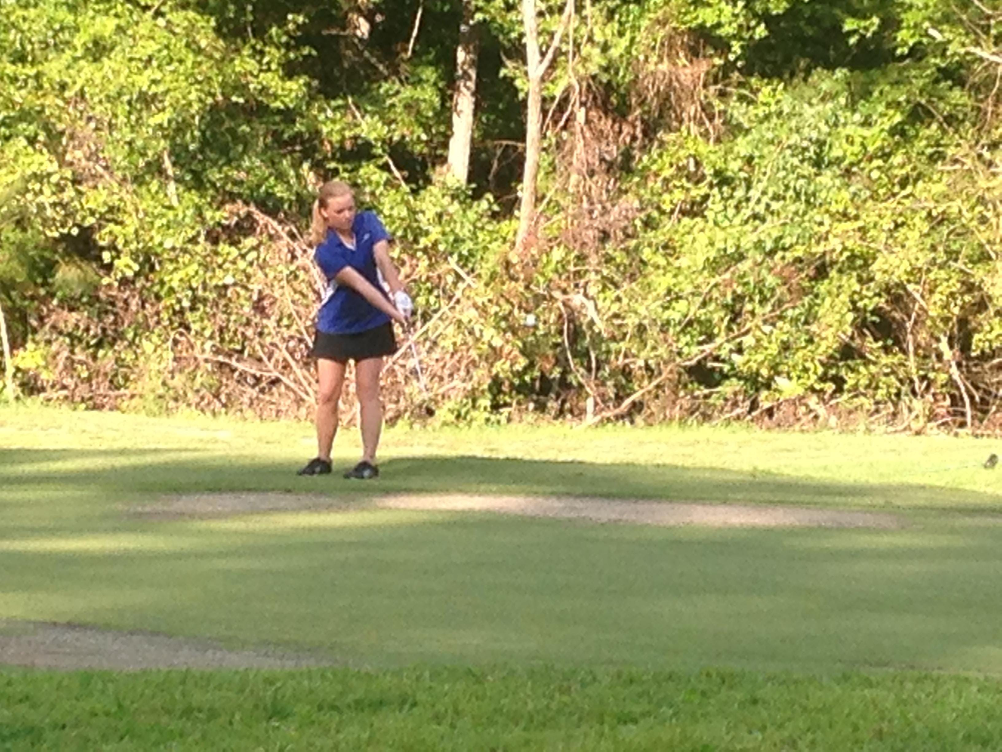 A Chester County golfer hits her ball toward the green Tuesday at Chickasaw Golf Club.