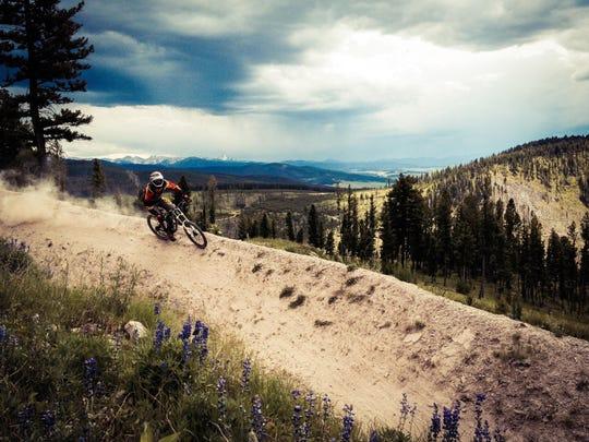 A mountain biker rides down a trail at Discovery Ski Area's bike park. The ski area has five named mountain bike trails.