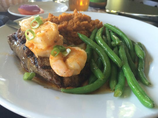 The St. Thomas Beef and Reef featuring a 10-ounce sirloin and shrimp from The Hut.