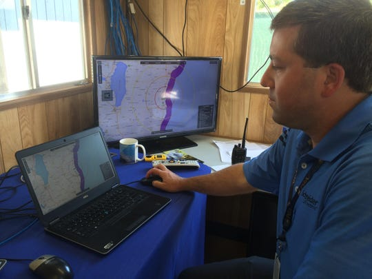 On-site PGA meteorologist Brad Nelson monitors the weather on Aug. 13 during the PGA Championship at Whistling Straits.
