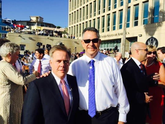 Alexandria businessman Mike Shelton (left) and U.S. Under Secretary of Commerce Frank Sanchez at the newly reopened U.S. Embassy in Cuba for the flag-raising ceremony Friday.