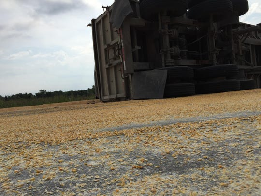 Corn is spread across Wadhams Road, south of Griswold Road, in Kimball Township following a Friday morning crash.