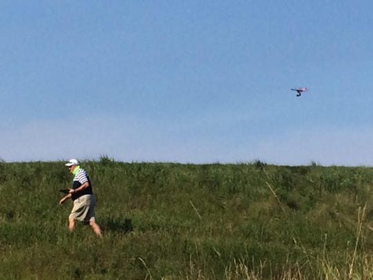 A drone hovers over Whistling Straits, capturing live footage of the PGA Championship on Aug. 12. It is the first time Turner Sports has utilized a drone for live sports coverage.