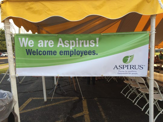 Vertical banner announce the new branding for Aspirus Riverview Hospital & Clinics.