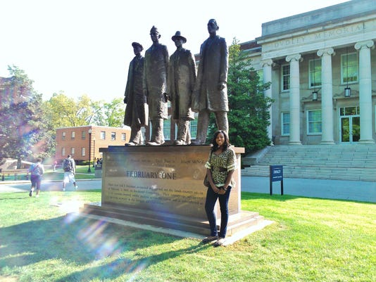 Me on the campus of North Carolina Agricultural and Technical State University in front of a memorial statue of the Greensboro Four. Every year, on February 1, the three living members come back to remember the sit-ins and the impact the had on society.