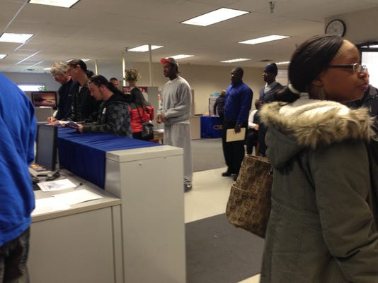 Job seekers wait in line at the PA CareerLink-York County on Friday.  More than 250 people attended a job fair held at the office last week.