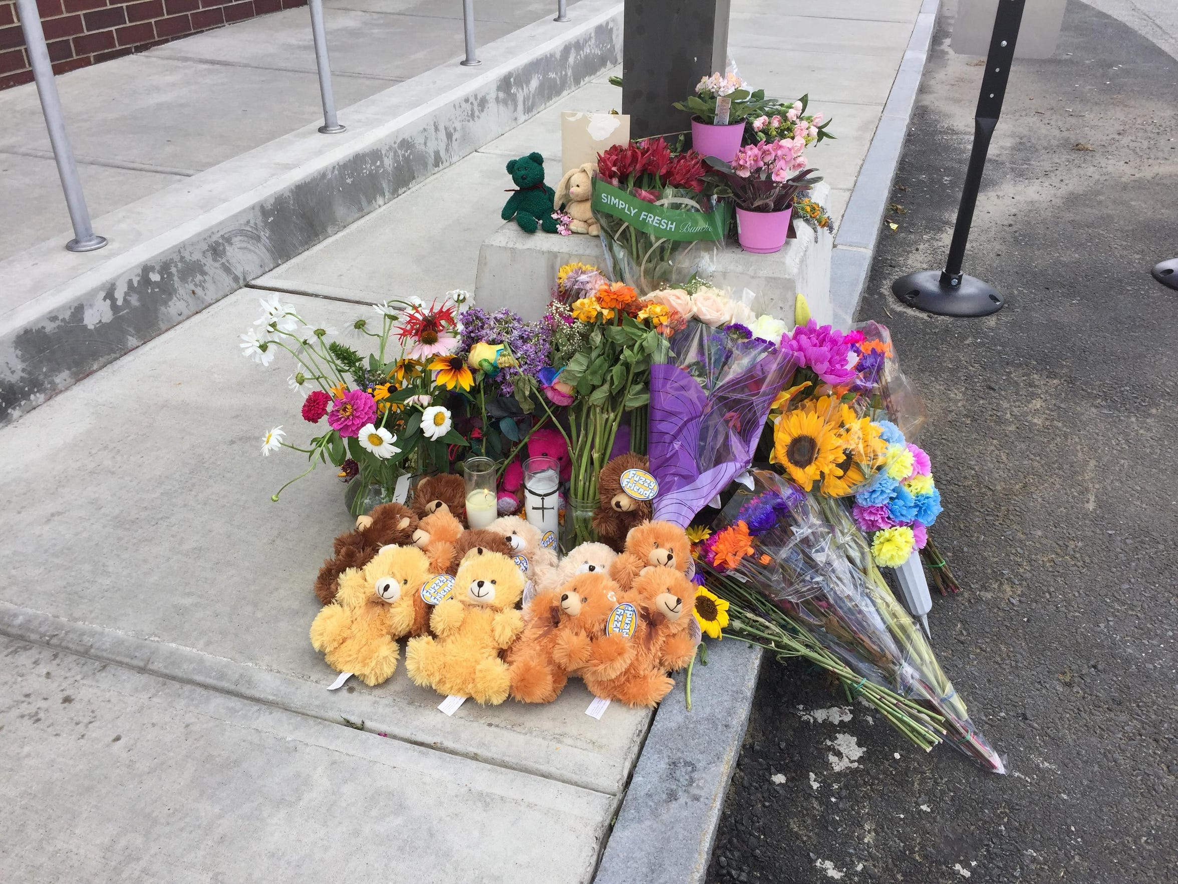 A memorial to slain Department for Children and Families social worker Lara Sobel grows Aug. 9 as mourners prepare for a vigil to remember her.